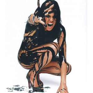 SheWired Shot of the Day: Michelle Rodriguez Gets Slick and Sexy for a Cause
