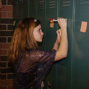 Michigan Middle School Student Counters Bullying with Positive Post-Its on Lockers