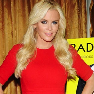 Watch Jenny McCarthy Recall Kissing Naked Playmates on a Beach
