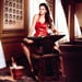 Shot of the Day: Penelope Cruz, an Anvil, Red Romper and Cats for Campari's Calendar
