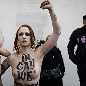 Watch: Topless Feminists Protest Antigay Demonstrations in France