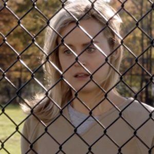 WATCH: 'Orange Is The New Black' Features Lead Whose Lesbian Affair Landed Her Behind Bars