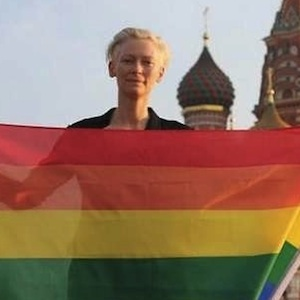 Shot of the Day: Tilda Swinton Wants You to Share this Pic of Her Waving a Rainbow Flag in Russia