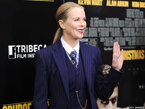 Shot of the Day: Kim Basinger is Sleek and Sexy in Pin-Striped Men's Suit